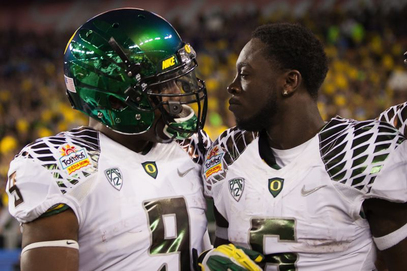 by: TRIBUNE PHOTO: MEG WILLIAMS - Oregon's Byron Marshall (left) congratulates De'Anthony Thomas after the latter's opening touchdown Thursday at Glendale, Ariz.