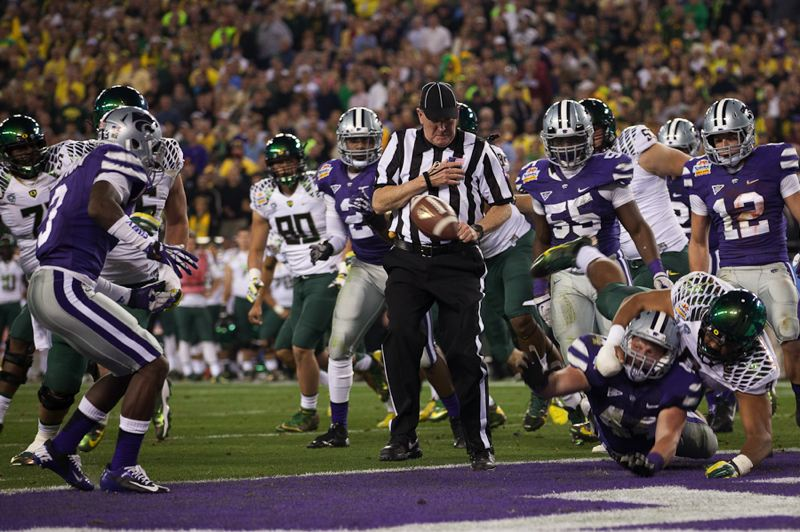 by: TRIBUNE PHOTO: MEG WILLIAMS - Kansas State tries to get the ball out of the end zone on what turned out to be a one-point safety for Oregon after a blocked point-after touchdown kick attempt.