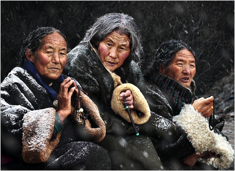 by: COURTESY OF CHAN KWOK HUNG - The 2011 Photo of the Year first place winner was Chan Kwok Hung of Hong Kong, whose photo, 'Pray,' was taken in Gansu Province of China, where Tibetan women were waiting for the Buddha festival outside of temple.