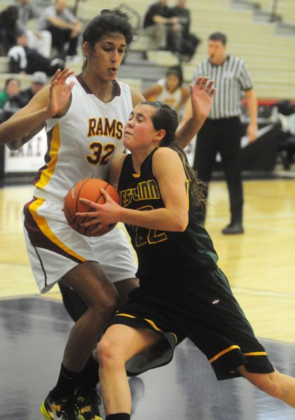 by: MATTHEW SHERMAN - Julia Boyd-Helm drives against a Central Catholic defender during the team's first-round game of the Interstate Shootout.
