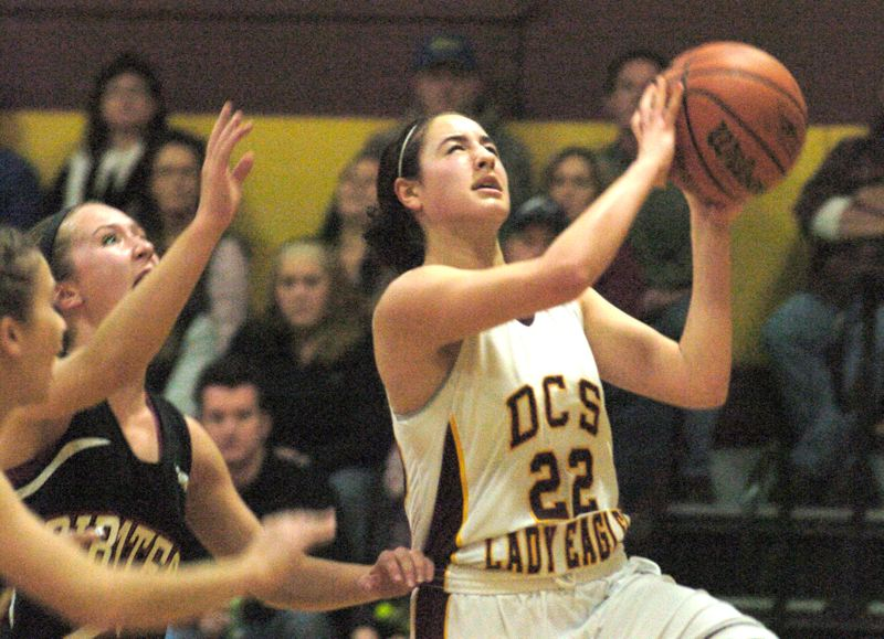 by: THE OUTLOOK: DAVID BALL - Damascus Christian's Lydia Marvin looks to finish a fastbreak during the Eagles 53-51 win over No. 6 Perrydale on Saturday night.