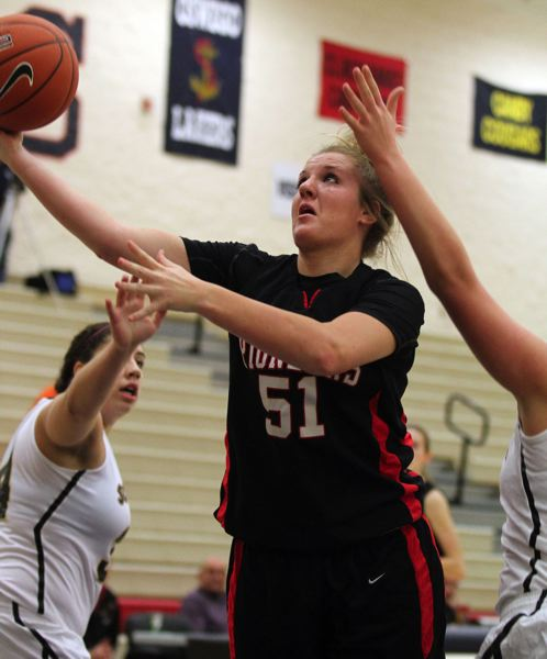 by: JONATHAN HOUSE - Oregon City senior post Johanna Paine takes the ball to the basket in the Pioneers Nike Interstate Shootout win over Southridge. The Pioneers suffered their first loss of the season in the tournament, but they are still ranked No. 1 in the state in the OSAA Class 6A power rankings.