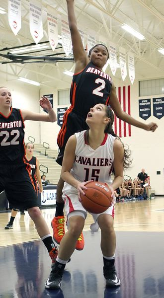 by: MILES VANCE - Clackamas junior wing Sydney Azorr (15) eyes the basket in the Cavaliers Nike Interstate Shootout win over seventh-ranked Beaverton.