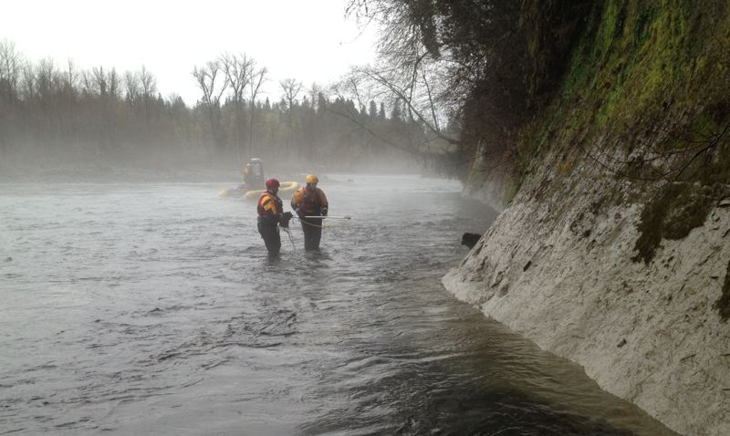 by: PHOTO COURTESY: CLACKAMAS COUNTY SHERIFF'S OFFICE - Clackamas County Sheriff's Office deputies rescue a 30-pound chow mix in the Clackamas River on Monday near Oregon City.