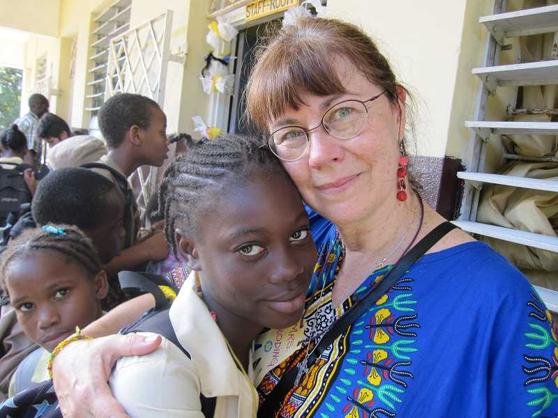 by: SUBMITTED PHOTO - Rosalie Broding has a love festival with the children of Jamaica every summer. It started as soon as she walked into her classroom for the first time in 2008.