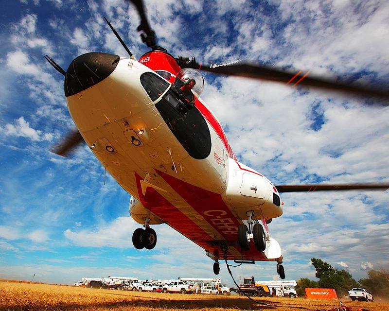 by: COURTESY OF COLUMBIA HELICOPTERS - A Boeing 234 helicopter, similar to this one, crashed in Peru during oil exploration operations and killed five Columbia Helicopter employees.