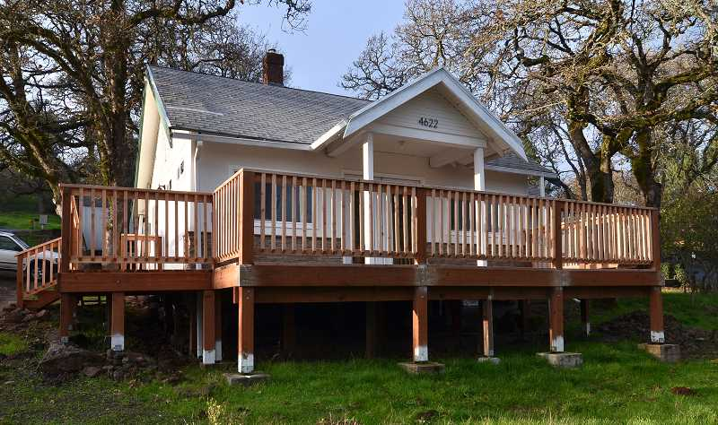 by: REVIEW, TIDINGS PHOTO: VERN UYETAKE  - Tom O'Neill purchased the home for $68,000 in June. In addition to many other renovations, he built the wrap-around porch.