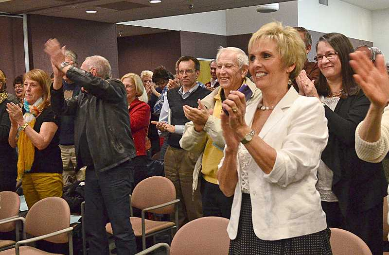 by: VERN UYETAKE - A large number of citizens, including Kim Studebaker, front right, wife of new Mayor Kent Studebaker, crowded council chambers at city hall on Tuesday, when the new mayor and three new councilors were sworn into office.