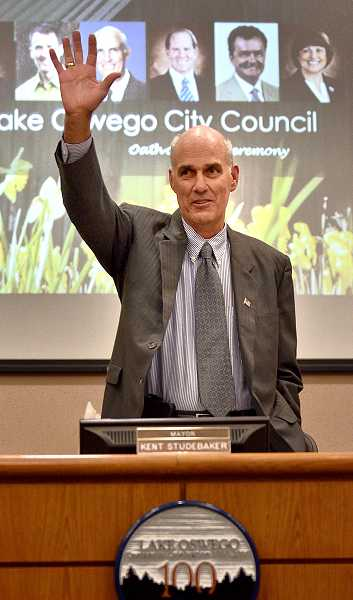 by: VERN UYETAKE - Mayor Kent Studebaker addresses a crowded room at city hall on Tuesday at the start of his first meeting in his new post leading the city council.