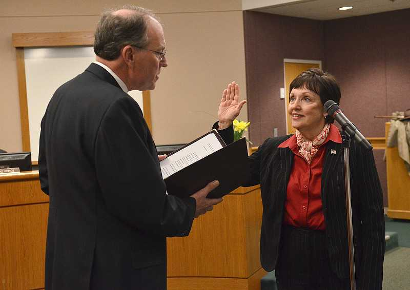 by: VERN UYETAKE - Councilor Karen Bowerman takes the oath of office Tuesday at city hall.