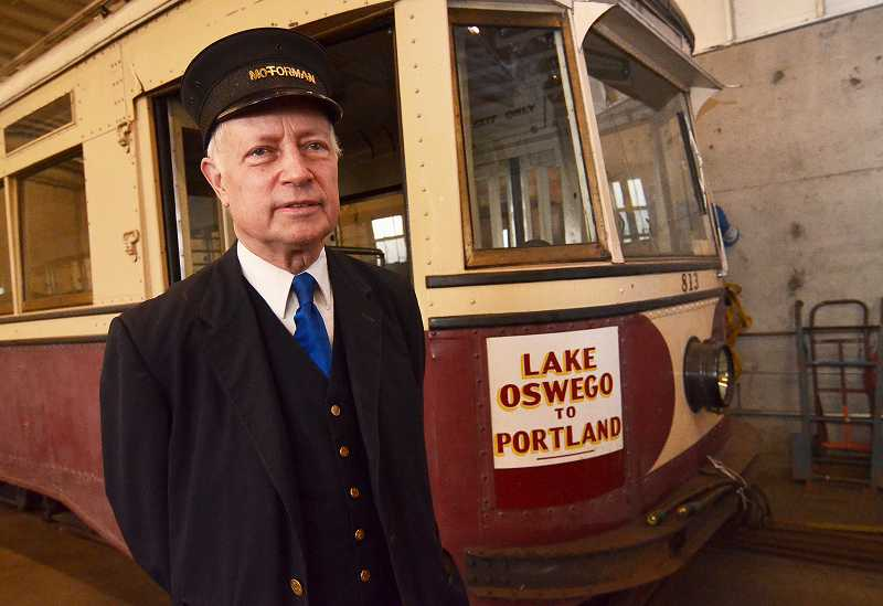 by: VERN UYETAKE - Rod Cox, general manager of the Willamette trolley, stands next to the antique Willamette Shore Trolley car in Lake Oswego's trolley barn off State Street last spring. While this 1932 streetcar was sent off for restoration work at the Oregon Electric Railway Museum in Brooks, a new vintage replica will soon be rolling on the tracks in Lake Oswego.