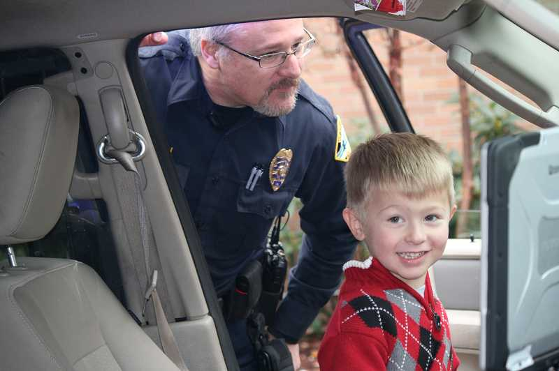 by: SUBMITTED - Nicholas Katko sat in a West Linn police car during the annual Santa Brunch on Dec. 9.