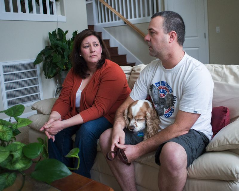 by: NEWS-TIMES PHOTOS: CHASE ALLGOOD - Jason and Laura Horner relate the events leading up to the Dec. 22 death of their son Jacob while the family dog rests in Jasons lap (above).