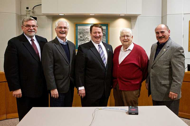 by: JAIME VALDEZ - Former Tigard mayors, from left, Tom Brian, Craig Dirksen, current Mayor John L. Cook, his father John E. Cook and Gerald Edwards stand together prior to Tuesday night's swearing in ceremony.