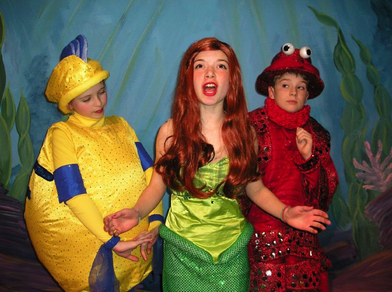 by: COURTESY PHOTO - Ariel (Emily Upton) sings to Sebastian and Flounder (David Van Dyke and Sara Johnson) of her desire to be part of the human world.