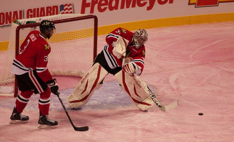 by: COURTESY OF JEFF HINDS - Mac Carruth, Portland Winterhawks goalie, keeps the puck out of the net en route to another victory.