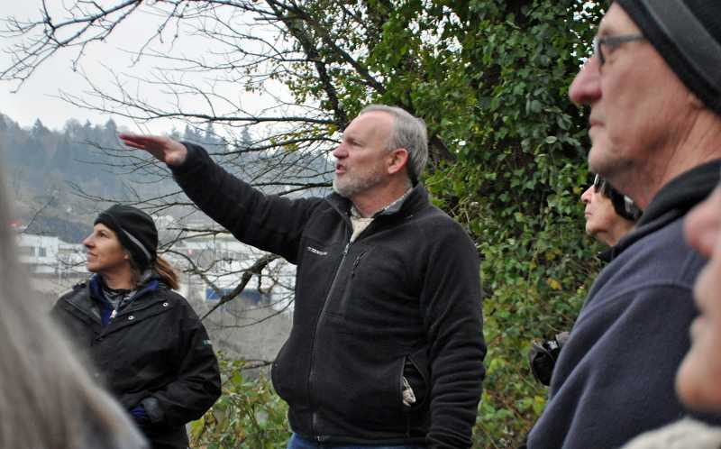 by: TONIA MCCONNELL - Roger Shepherd shared facts and stories about West Linn, Oregon City and the Willamette River with walk participants.