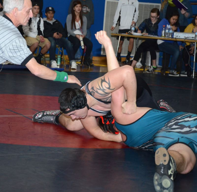 by: JOHN BREWINGTON - Scappoose's Devin Ray  just about has his Century opponent pinned during last week's tournament.