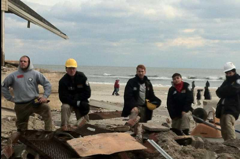 by: SUBMITTED - Josh Israel, left, and his co-workers take a breather from their heavy duty. The 19-year-old FEMA volunteer from Lake Oswego felt he learned much from his service after Hurricane Sandy.