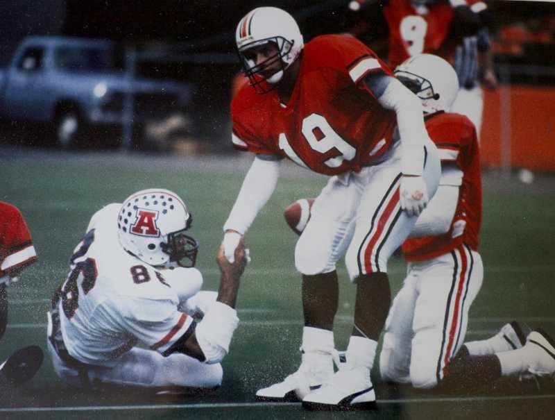 by: FILE PHOTO - Mike Lopez Jr. helps up an Arizona opponent during his football career at Oregon State.