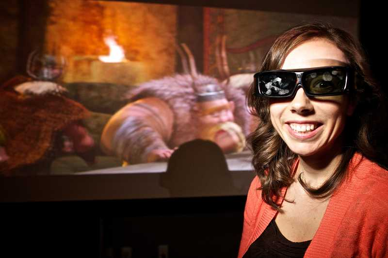 by: TIMES PHOTO: JAIME VALDEZ - With the animated 3-D Viking odyssey,'How to Train Your Dragon,' playing on the screen behind her, Ami Halvorson, director of the Pacific EyeClinic Beaverton demonstrates the one-of-a-kind diagnostic technology in the 3-D performance clinic at The Round at Beaverton Central.