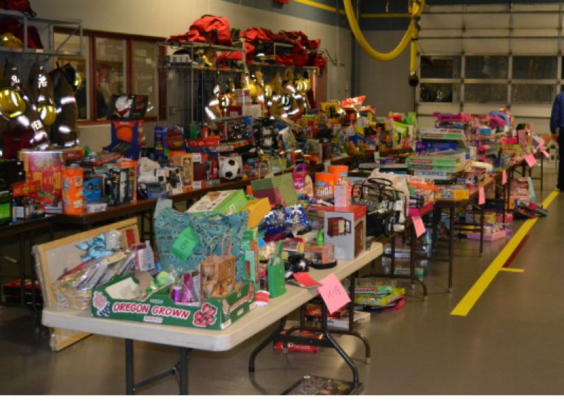 by: CONTRIBUTED PHOTO - CONTRIBUTED PHOTO Some of the Christmas gifts and food baskets are seen inside the Boring fire station while they were being assembled for delivery to qualifying families. Nearly 400 people benefitted from this annual event.