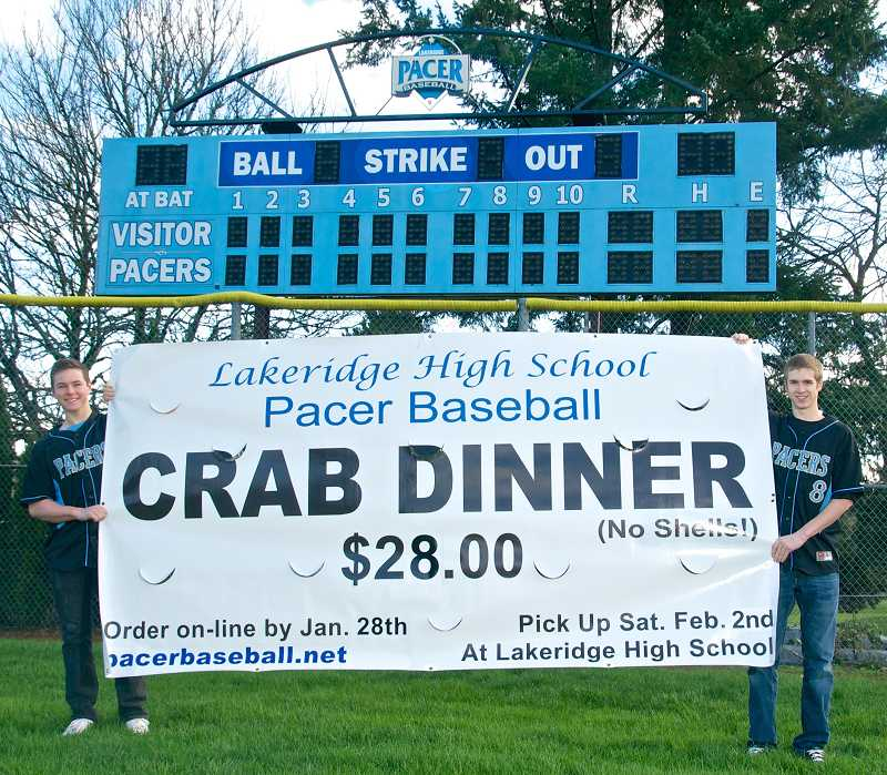 by: SUBMITTED PHOTO - Lakeridge High School seniors Cooper Hummel and Rick Hiller hold the crab feed flier.