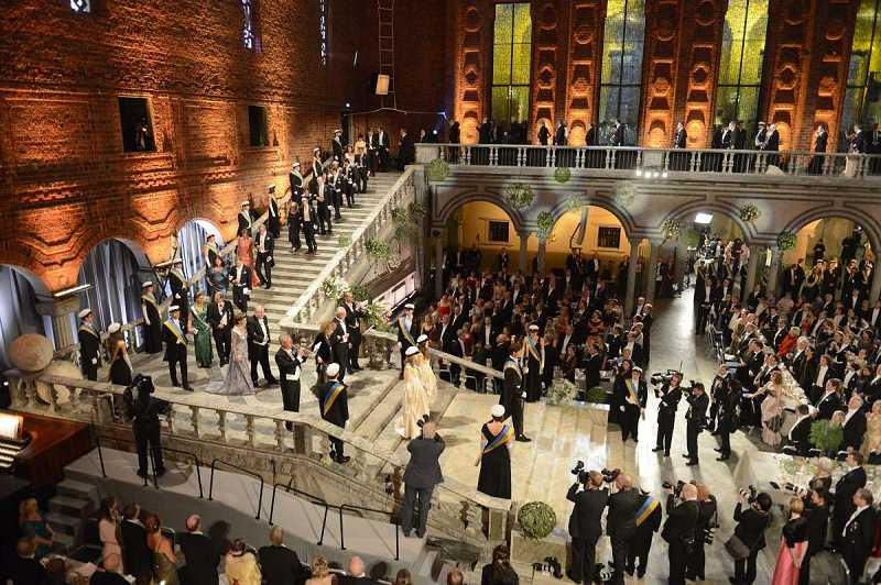 by: SUBMITTED - The giant staircase of Stockholm City Hall makes an awesome setting for the arrival of Noble Prize Award Ceremony guests.
