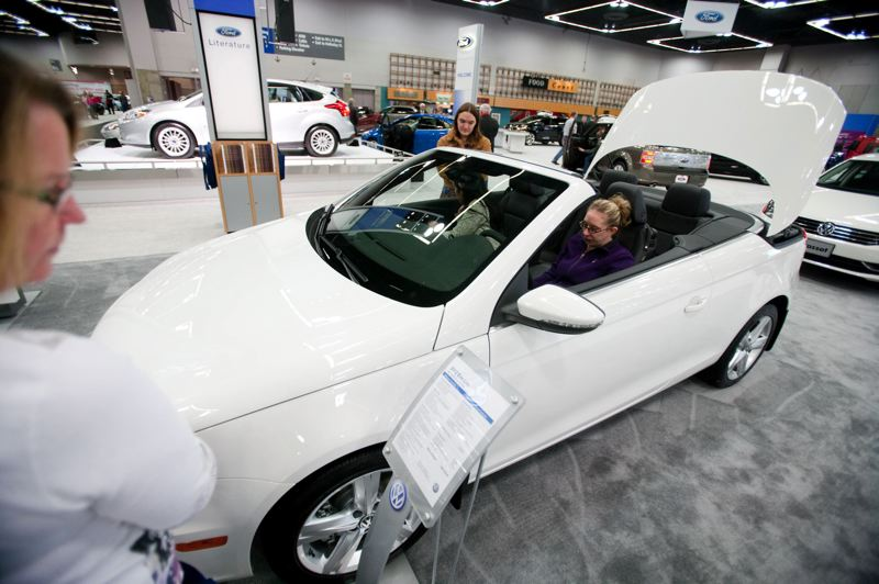 by: TRIBUNE PHOTO: CHRISTOPHER ONSTOTT - The 2012 VW Eoss power folding hardtop was a big hit at the Portland Auto Show last year. The Oregon Convention Center will host the 2013 Auto Show again this year.