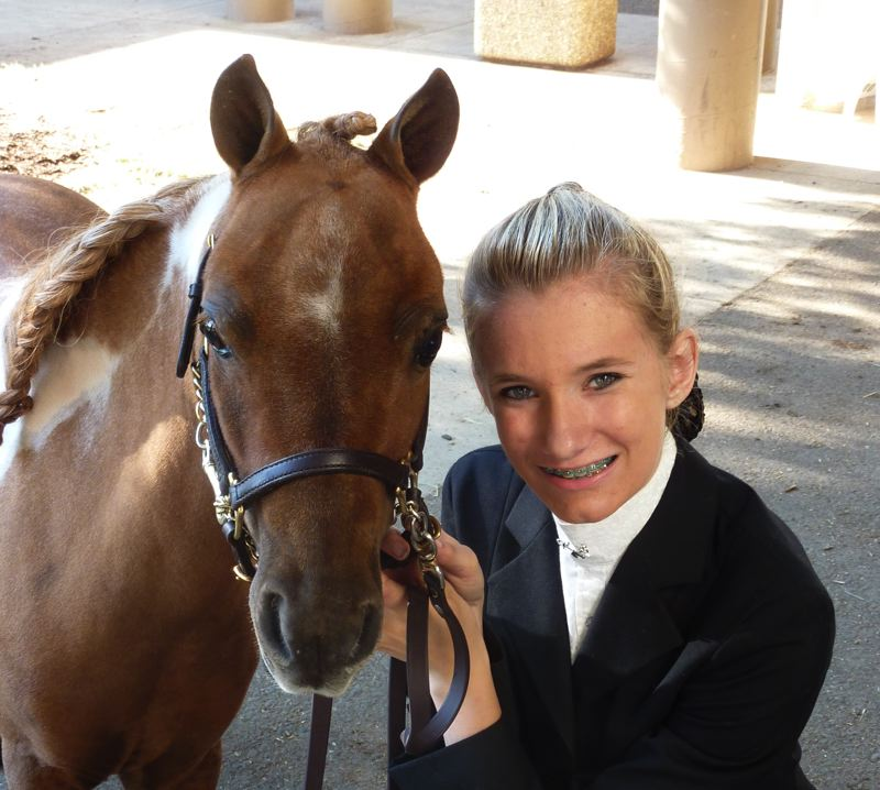by: CONTRIBUTED PHOTO - Courtney Helgeson poses with Stoney, her mini horse.