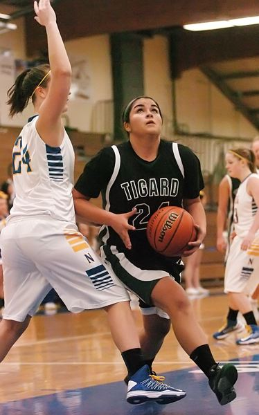 by: DAN BROOD - STRONG INSIDE -- Tigard senior Julia Santos looks to go up to the basket agaist Newberg's Abbie Woginrich.