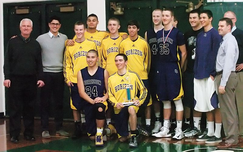 by: DAN BROOD - THE CHAMPS -- Horizon Christian players and coaches pose with the championship trophy following the Hawks' victory over Pleasant Hill.