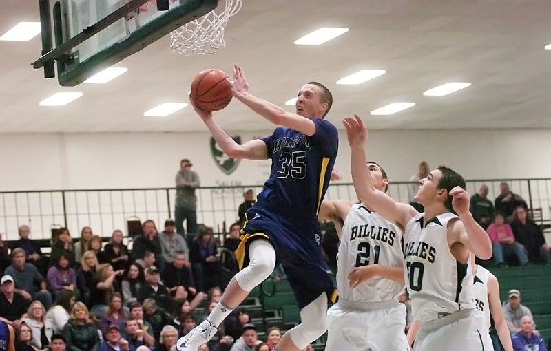 by: DAN BROOD - GOING UP -- Horizon Christian senior Calvin Anderson goes past Pleasant Hill's Rhyland Hayter (21) and Jackson Bertsch and soars to the basket during Saturday's tournament final.