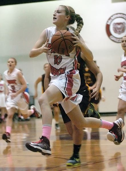 by: DAN BROOD - TOP SCORER -- Tualatin senior Britta Hall scored 20 points in the victory over Forest Grove.