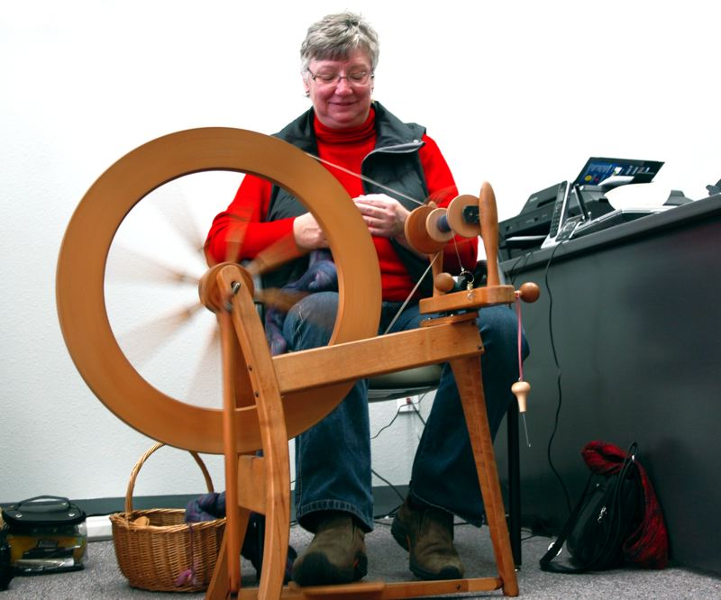 by: NEWS PHOTO: SCOTT JORGENSEN - Juli Sampson operates her spinning wheel during one of the groups recent Friday afternoon gatherings.