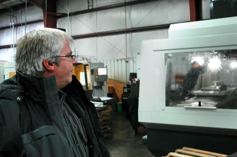 by: NEWS PHOTO: SCOTT JORGENSEN - Sale supervises one of the companys 90 employees during a recent workday.