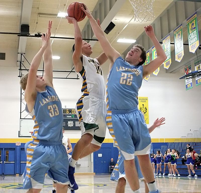 by: MILES VANCE - CHALLENGING - Aloha junior Edgar Guerra attacks the basket and gets his shot blocked by Lakeridge's Patrick Jaco during the Warriors' non-league Tuesday home loss.