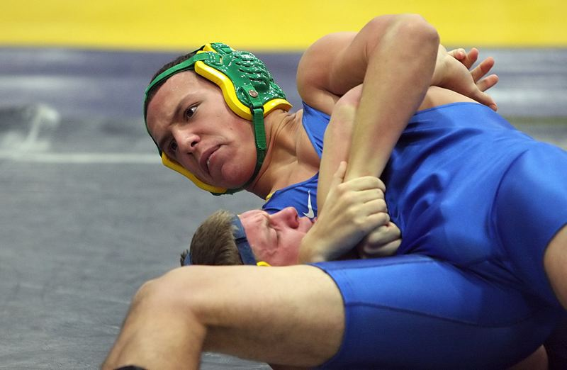 by: MILES VANCE - COUNTING DOWN - Aloha senior Concepcion Rodelo puts the squeeze on Barlow's Ty Haggerty in their match at 182 pounds during Friday's Aloha Dual Challenge tournament. Rodelo won the match with a 31-second pin over Haggerty.