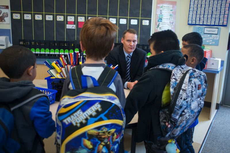 by: HILLSBORO TRIBUNE PHOTO: CHASE ALLGOOD - Superintendent Mike Scott meets with students at Witch Hazel Elementary School. Hillsboro, like other districts, will grapple with funding this year.