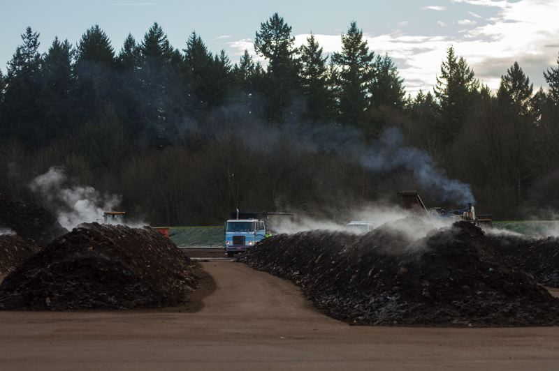 by: HILLSBORO TRIBUNE PHOTO: CHASE ALLGOOD - Piles of compost create steam on top of a newly paved section of the Nature´s Needs composting plant.
