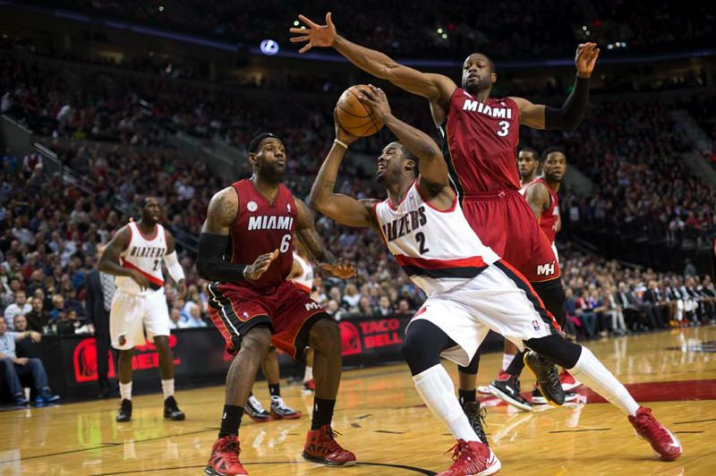 by: TRIBUNE PHOTO: CHRISTOPHER ONSTOTT - Wesley Matthews drives for the Trail Blazers between defenders LeBron James and Dwyane Wade (right).