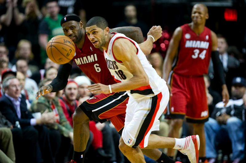 by: TRIBUNE PHOTO: CHRISTOPHER ONSTOTT - Forwards Nicolas Batum of the Trail Blazers and LeBron James (left) of the Miami Heat go for a loose ball, as Batum forces a turnover.
