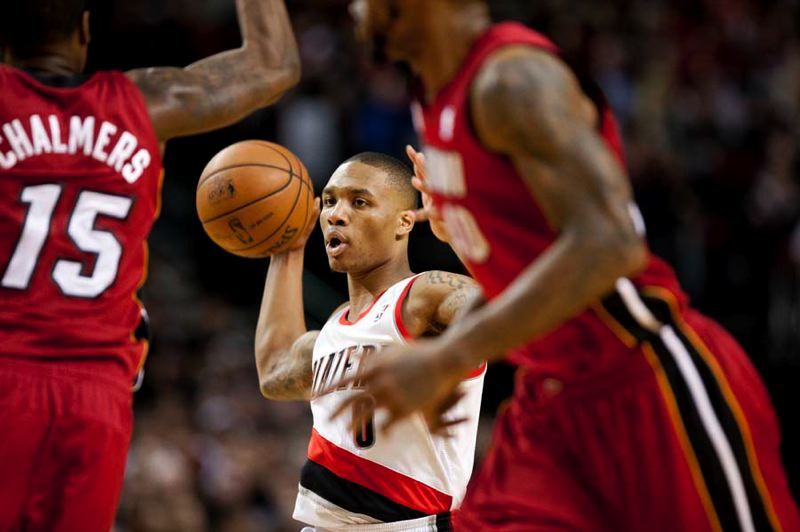 by: TRIBUNE PHOTO: CHRISTOPHER ONSTOTT - Portland point guard Damian Lillard makes a pass to Nicolas Batum for an assist.