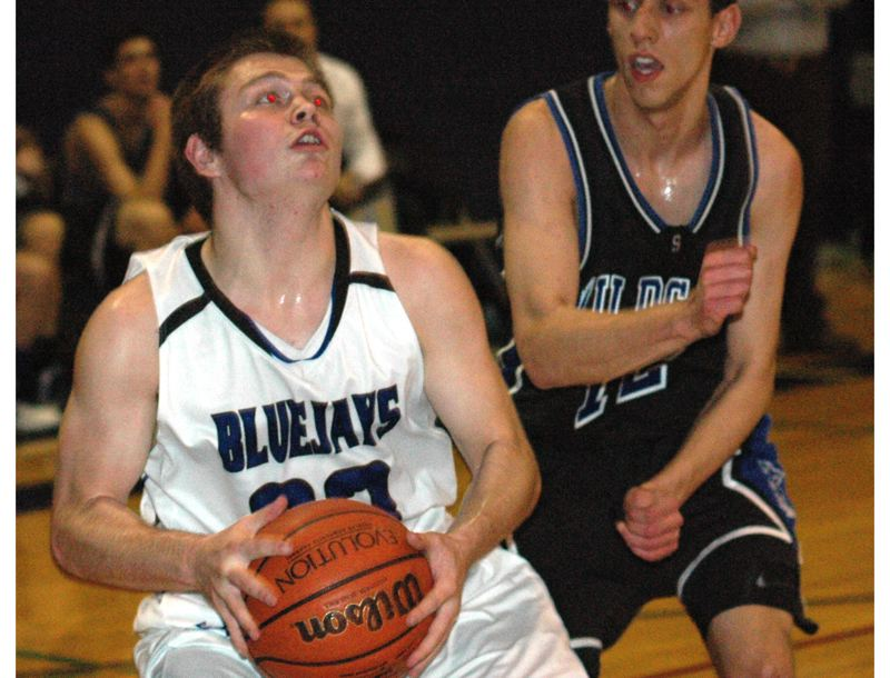 by: THE OUTLOOK: PARKER LEE - Portland Lutherans Matt Risser looks to go up to the hoop during Tuesdays loss to SW Christian.