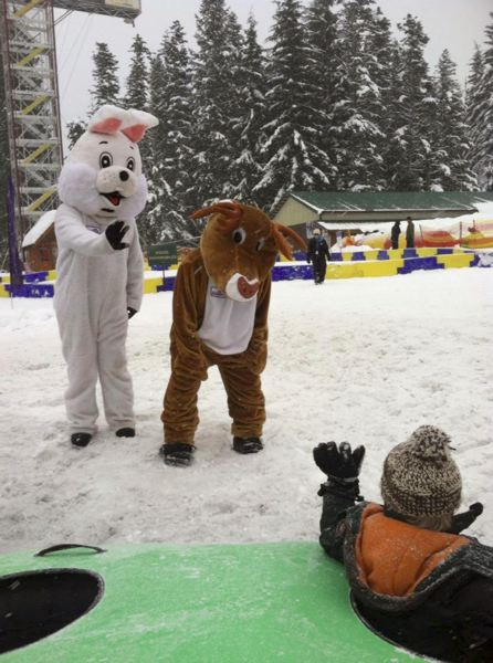 by: CONTRIBUTED PHOTO - Two AntFarm members entertain a child at SkiBowls Adventure Park.