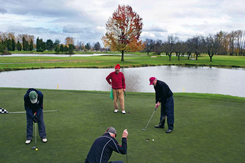 by: TRIBUNE PHOTO: CHRISTOPHER ONSTOTT - Heron Lakes Golf Course in North Portland is slowly switching to bentgrass on its greens, lowering its maintenance costs and its use of pesticides.