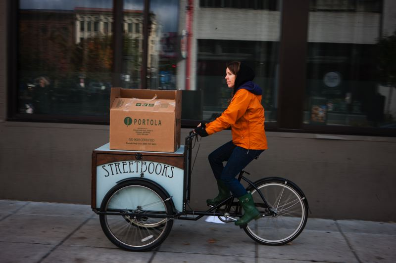 by: PAMPLIN MEDIA GROUP: CHRISTOPHER ONSTOTT - Laura Moulton started her pedal-powered library for the homeless with $4,000 raised over Kickstarter. Shes one of several Portlanders using the web fundraising service for sustainability themed projects.