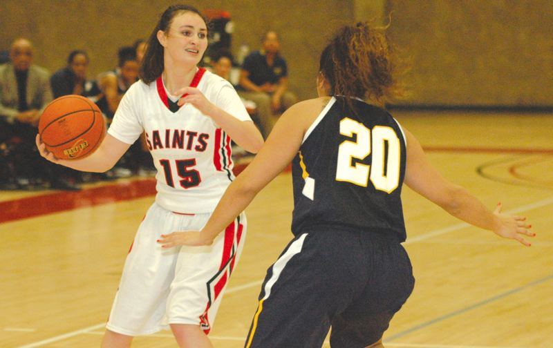 by: THE POST: PARKER LEE - Mt. Hoods Leslie Capps looks for an open passing lane during Wednesdays loss to Portland CC.
