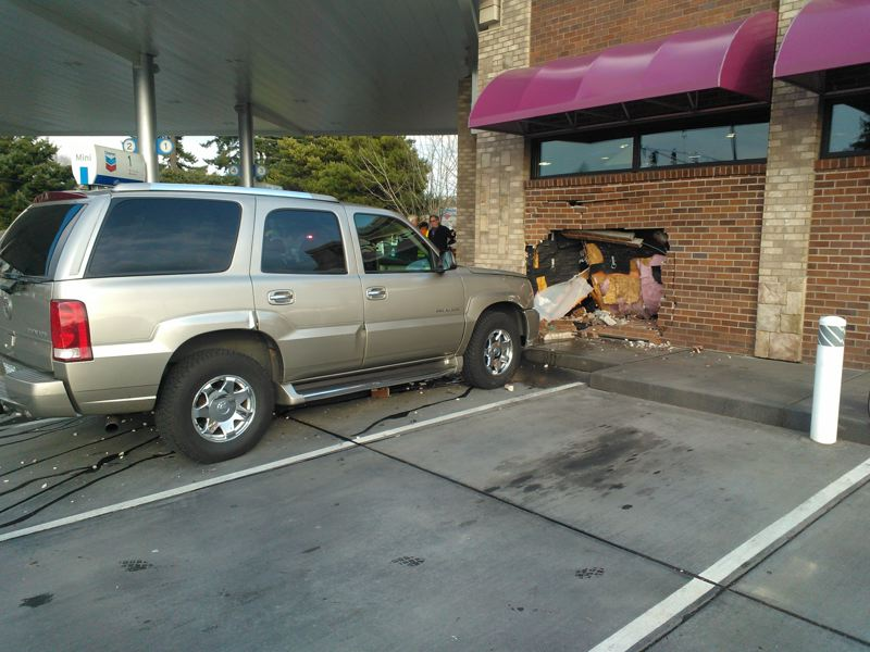 by: SUBMITTED PHOTO - Gabriel Sugarman was cited for careless driving after slamming into the Chevron gas station building at 14470 S.W. Allen Blvd.