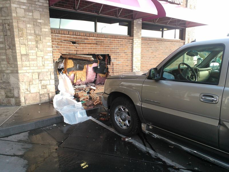 by: SUBMITTED PHOTO - Beaverton police say the driver was attempting to park his 2003 Cadillac Escalade when he stepped on its accelerator rather than the brake.